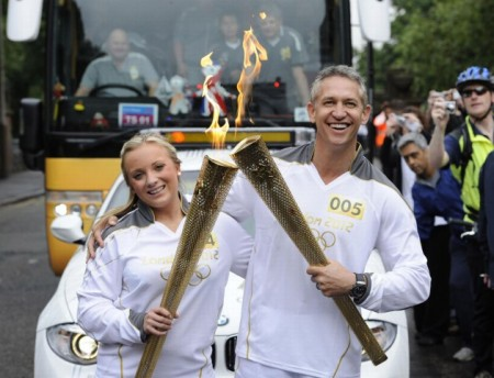 Pennelope Allman passing the Olympic Flame to former footballer and TV presenter Torchbearer 005 Gary Lineker on the Torch Relay leg through Leicester